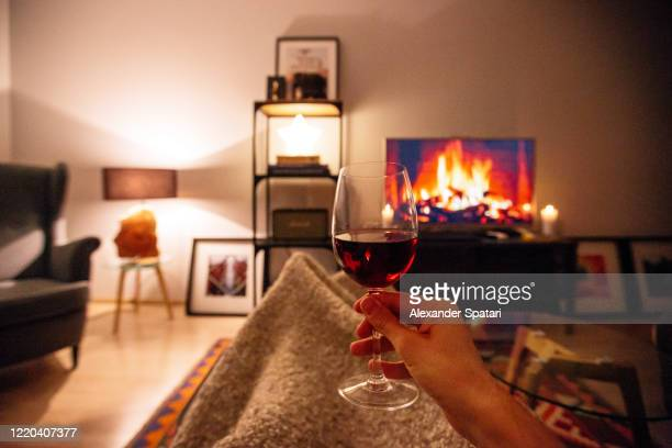 drinking wine and relaxing on the couch at home, personal perspective point of view - cosy stock pictures, royalty-free photos & images