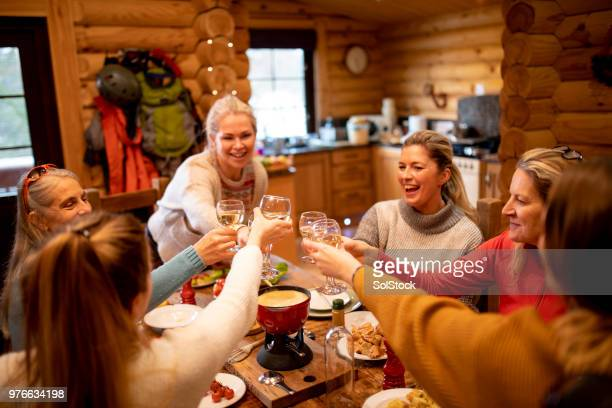 drinking wine at dinner - apres ski stock pictures, royalty-free photos & images