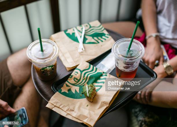 Drinks and a piece of pastry is seen on a customer's table inside Kyoto's new Starbucks branch with a traditional Japanese space on June 30 2017 in...