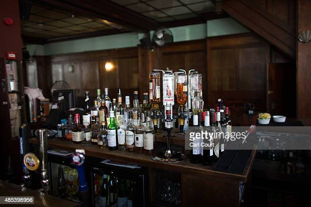 Drinks are displayed behind the bar of the Royal Oak pub on Columbia Road on August 27 2015 in London England The Royal Oak pub was named as one of...