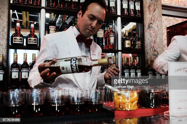 Drinks are prepared with Campari liqueur at Bar Convent Brooklyn an international bar and beverage trade show at the Brooklyn Expo Center on June 12...