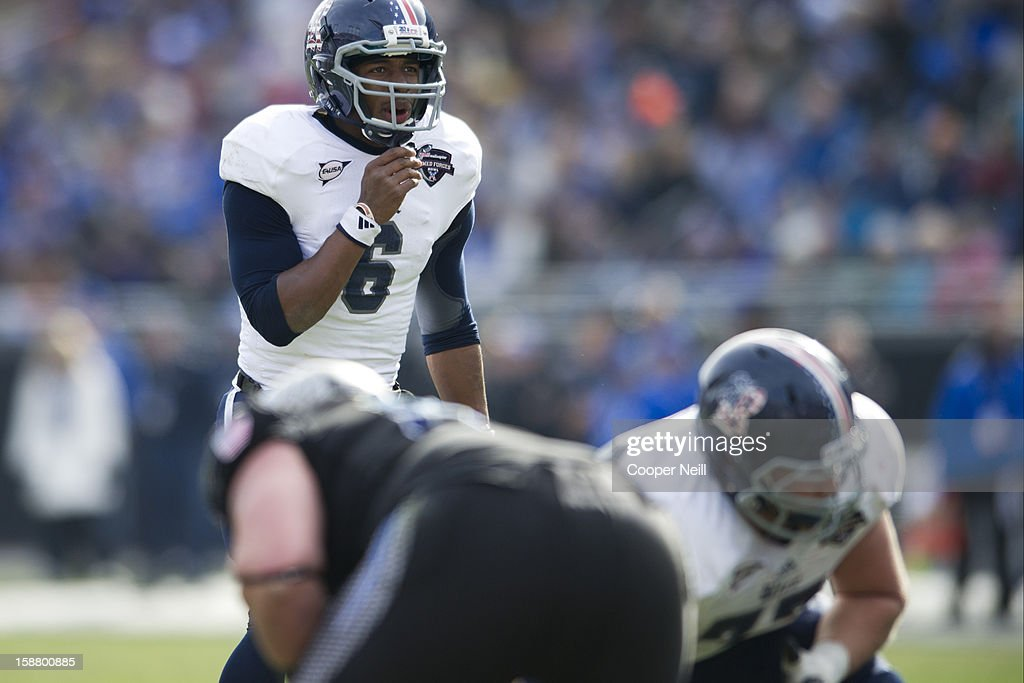 Driphus Jackson #6 of the Rice Owls calls a play at the line of scrimmage against the Air Force Falcons on December 29, 2012 during the Bell Helicopter Armed Forces Bowl at Amon G. Carter Stadium in Fort Worth, Texas.