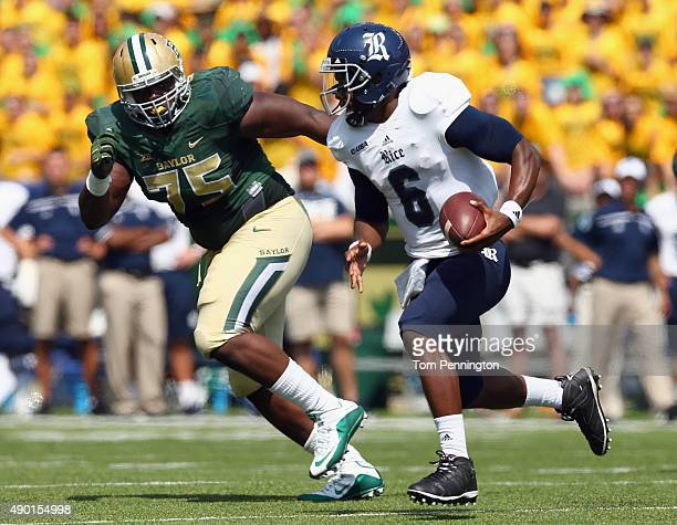 Driphus Jackson of the Rice Owls carries the ball against Andrew Billings of the Baylor Bears in the first quarter at McLane Stadium on September 26...