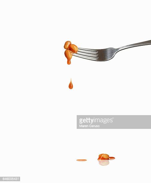 dripping beans on fork - sauce stock pictures, royalty-free photos & images