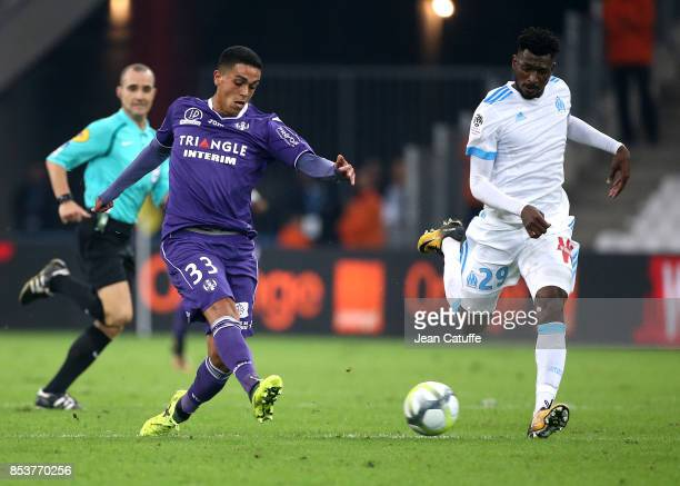 Driss Khalid of Toulouse Andre Zambo Anguissa of OM during the French Ligue 1 match between Olympique de Marseille and Toulouse FC at Stade Velodrome...