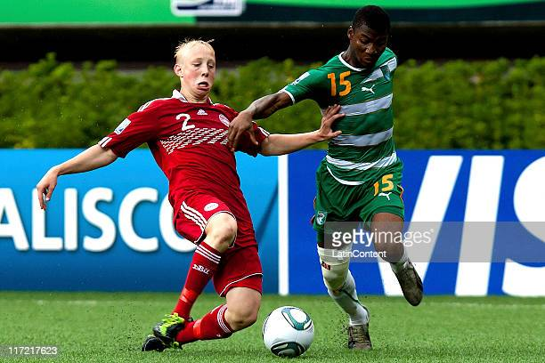 Drissa Diarrassouba of Ivory Coast struggles for the ball with Mads Aaquist of Denmark during the FIFA U17 World Cup Mexico 2011 Group F match...