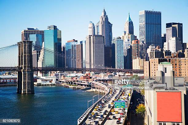 fdr drive and brooklyn bridge beneath manhattan skyline - billboard highway stock pictures, royalty-free photos & images