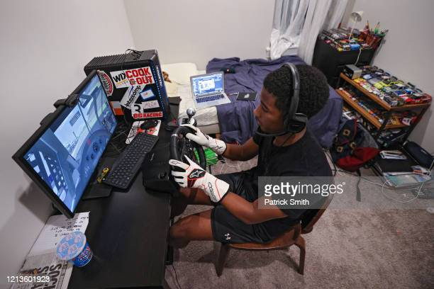 Drive For Diversity Driver, Rajah Caruth competes in theeTruck Series Night in America Powered by FilterTime,a live-online NASCAR Truck Series race...