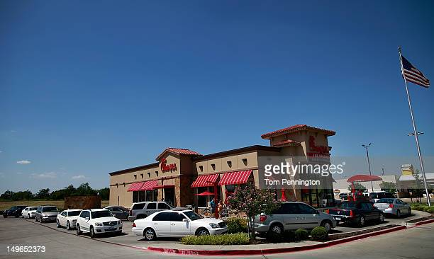 Drive through customers wait in line at a ChickfilA restaurant on August 1 2012 in Fort Worth Texas ChickfilA resturants across the country...