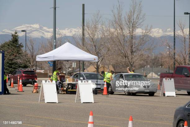 drive up covid 19 vaccine clinic in parking lot commerce city colorado - commerce city colorado stock pictures, royalty-free photos & images