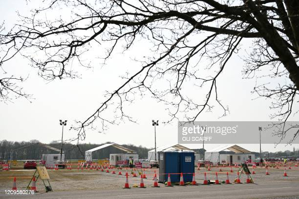 A drivein testing station for the novel oronavirus COVID19 is neardeserted at Haydock Park Racecourse in Merseyside North West England on April 10...