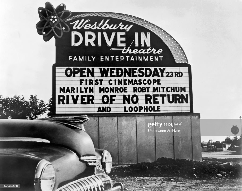 Drive-in theater sign advertising 'River Of No Return,' starring Robert Mitchum and Marilyn Monroe, Westbury, New York, 1954.