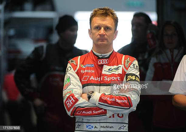 Driver Allan McNish of Scotland stands in the pit during last lap of his Danish teammate in their Audi R18 etron quattro during the 90th edition Le...