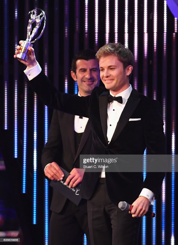 F1 Driver and Laureus Ambassador Nico Rosberg of Germany with his Laureus World Breakthrough of the Year Award as Academy Member Luis Figo looks on during the 2017 Laureus World Sports Awards at the Salle des Etoiles,Sporting Monte Carlo on February 14, 2017 in Monaco, Monaco.