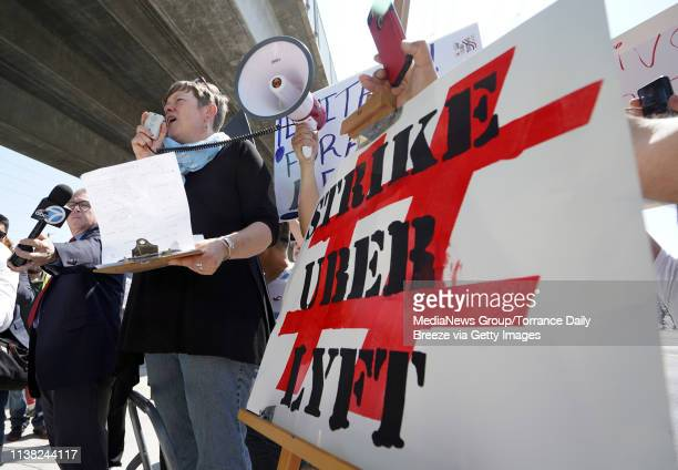 Driver and strike organizer Nicole Moore speaks during a oneday strike against Uber and Lyft in front of an Uber office on Marine Avenue in Redondo...
