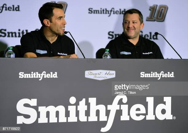 NASCAR driver Aric Almirola speaks with the media as Tony Stewart coowner of StewartHaas Racing looks on during a press conference at StewartHaas...