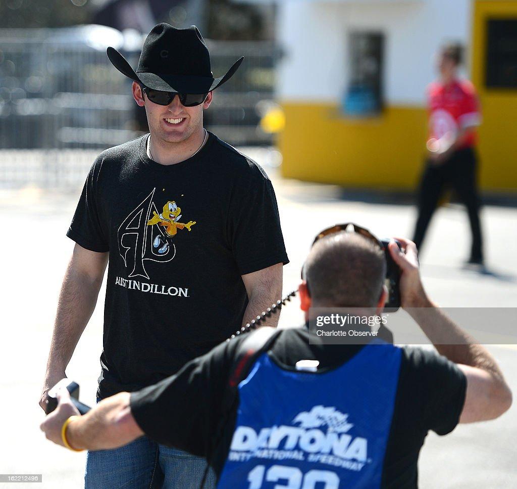 NASCAR driver Austin Dillon flashes a smile to a photographer as he walks through the garage area prior to practice on Wednesday, Febraury 20, 2013, at Daytona International Speedway in Daytona Beach, Florida.