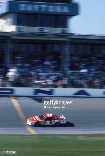 NASCAR driver Bill Elliott crosses the finish line to win the 1987 Daytona 500 on February 15 1987 at the Daytona International Speedway in Daytona...