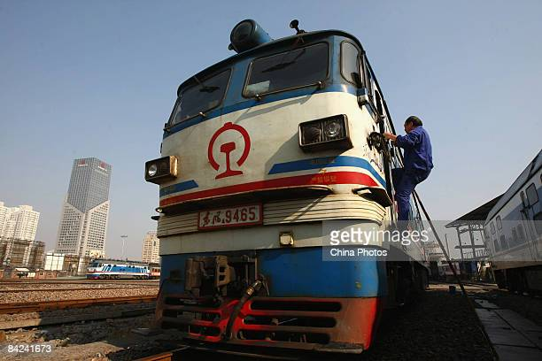 A driver boards a train at the Wenzhou Railway Station on January 11 2009 in Wenzhou of Zhejiang Province China Spring Festival travel season has...