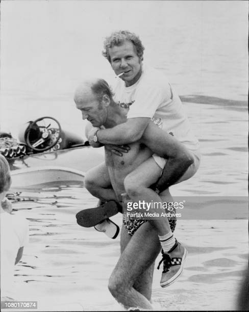 Driver Bob Saniga who reached a speed of 135 mph being carried across the water after his heat by his engineer John Allison of VictoriaThe Sydney...