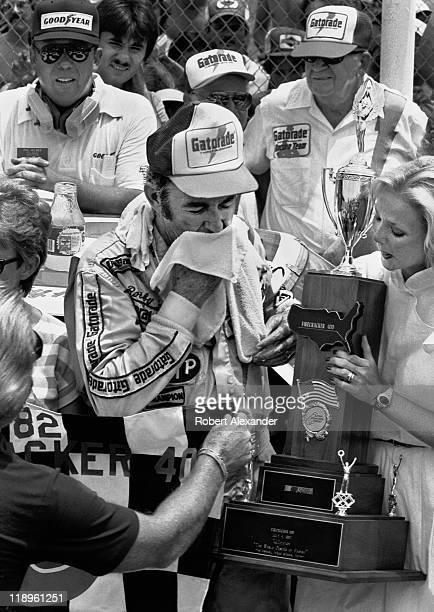 NASCAR driver Bobby Allison celebrates his 1982 Firecracker 400 win in Victory Lane on July 4 1982 at the Daytona International Speedway in Daytona...