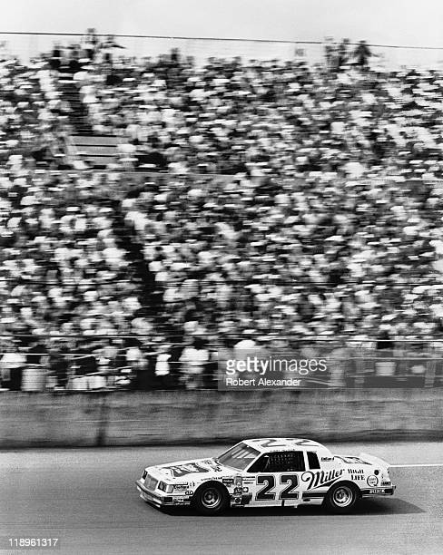 NASCAR driver Bobby Allison drives past the Daytona International Speedway grandstands during the 1987 Daytona 500 on February 15 1987 in Daytona...