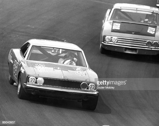 Driver Bobby Allison in his Dodge passes brother Donnie Allison during action at the Southeastern 500 race on March 23 1969 at the Bristol...