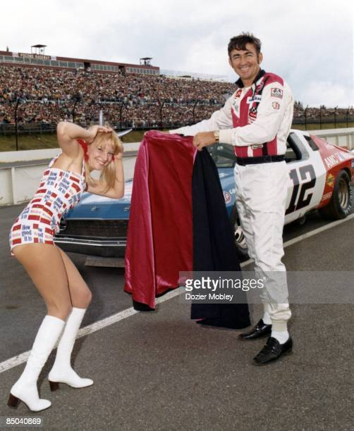 Driver Bobby Allison plays the Matador and Miss Winston Bee Bop Hobel plays the bull before the CocaCola 500 race on July 31 1977 at the Pocono...
