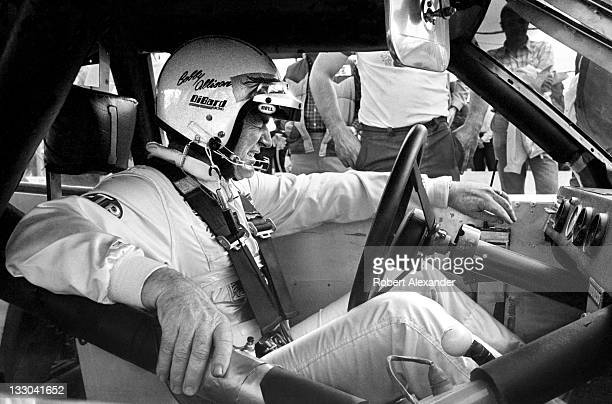 NASCAR driver Bobby Allison prepares for the start of the 1983 Firecracker 400 at the Daytona International Speedway on July 4 1983 in Daytona Beach...