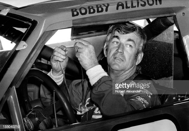 NASCAR driver Bobby Allison prepares for the start of the 1984 Daytona 500 on February 19 1984 at the Daytona International Speedway in Daytona Beach...