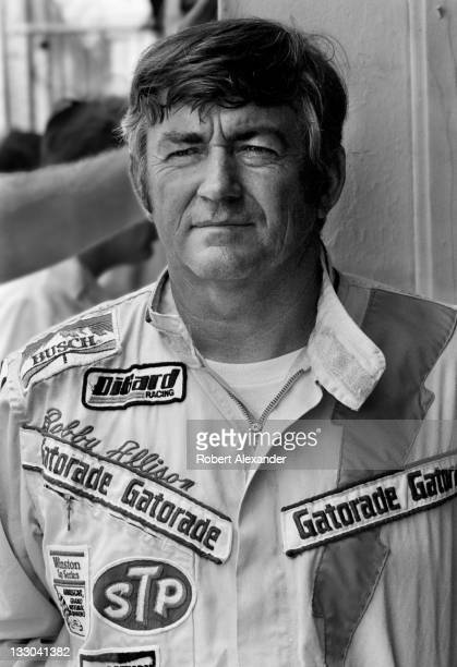 NASCAR driver Bobby Allison stands in the Daytona International Speedway garage prior to the start of the 1982 Daytona 500 on February 14 1982 in...