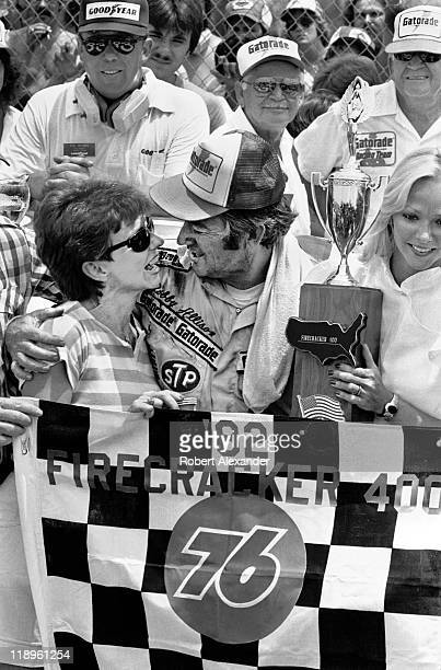 NASCAR driver Bobby Allison stands with his wife Judy as they celebrate his 1982 Firecracker 400 win in Victory Lane on July 4 1982 at the Daytona...