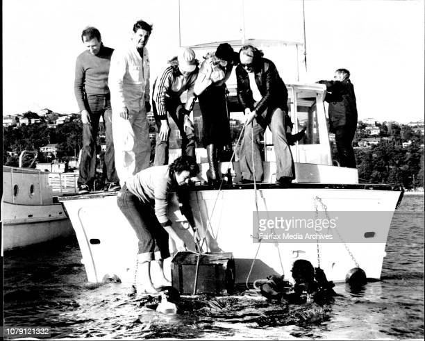 Driver Bruce Higgs who found the treasure chest police diver Senior Const Graeme Jamieson 2Sm disc jockey George Mooe and a much relieved Susie De...