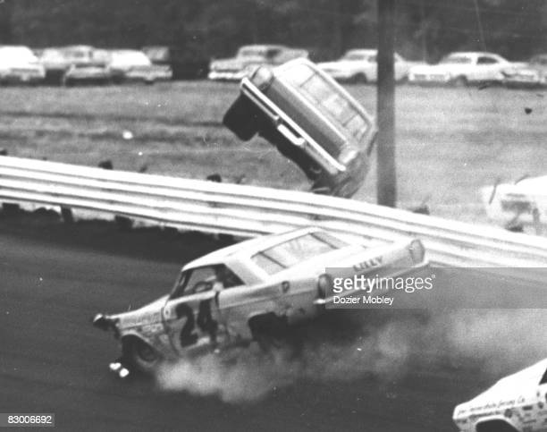 Driver Cale Yarborough goes over the wall in his Banjo Matthews 1965 Ford after being wrecked by Sam McQuagg at the Southern 500 on September 6 1965...