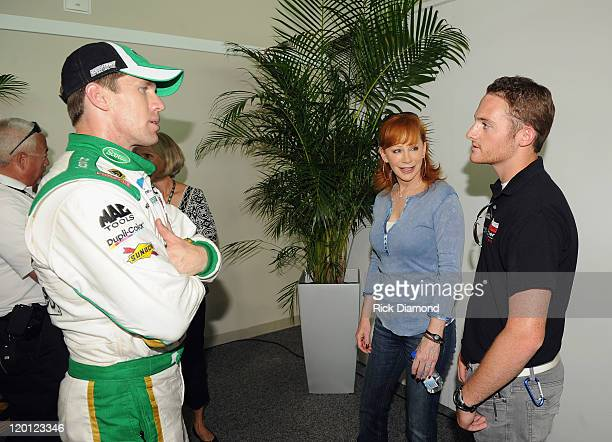 NASCAR driver Carl Edwards Reba McEntire and GrandAm Continental Tire Challenge driver Shelby Blackstock arrive for the Brickyard 400 Qualifying...