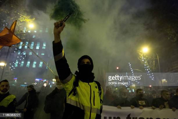 Driver carries a smoke bomb during the demonstration. EMT workers protest supported by Metro and taxi workers. The bus drivers of the public urban...