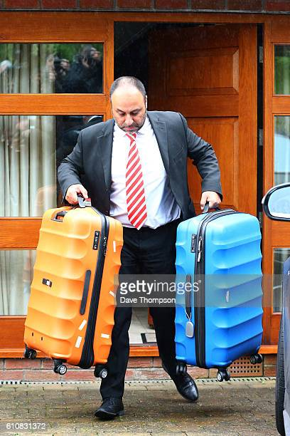 A driver carries cases from the family home of former England manager Sam Allardyce on September 28 2016 in Bolton England Allardyce left his...