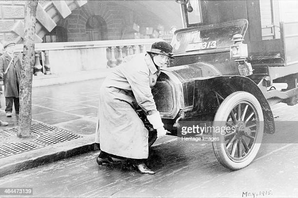 Driver Charlotte Marsh who had been a suffragette starting up a van April 1915 This image was used to illustrate an article in the Suffragette...