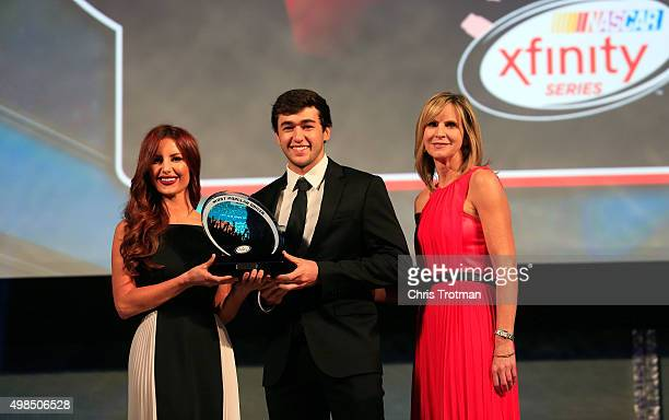 Driver Chase Elliott receives the 2015 Most Popular Driver award from Jill Gregory and Miss Coors Light Amanda Mertz during the NASCAR Camping World...