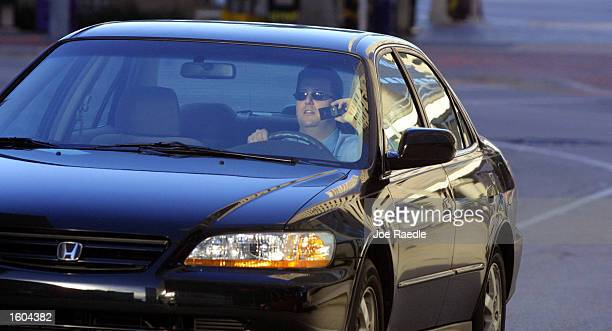 A driver chats on his cell phone July 25 2001 in his car in Miami Florida MiamiDade commissioners took the first step Tuesday toward approving an...