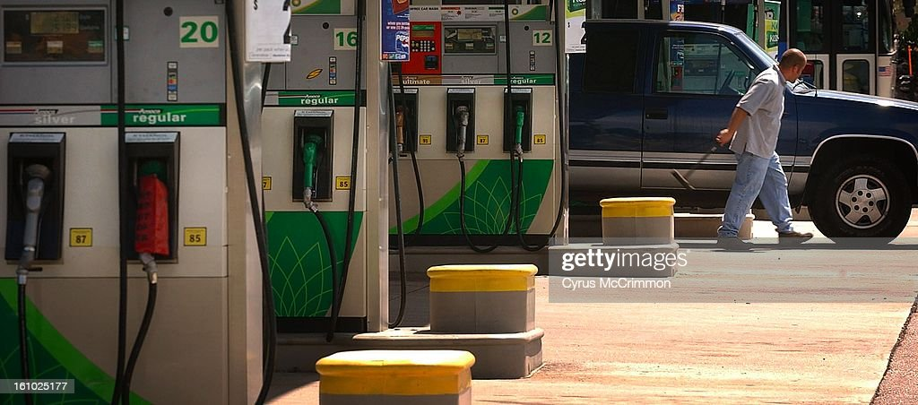A driver cleans his wind shields at the pumps on Tuesday, August 27