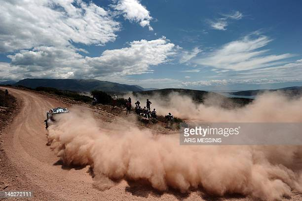 A driver competes during the Bauxites special stage of the WRC Acropolis rally in Itea on May 25 2012 AFP PHOTO / ARIS MESSINIS
