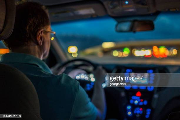 driver concentrating at night - driving stock photos and pictures