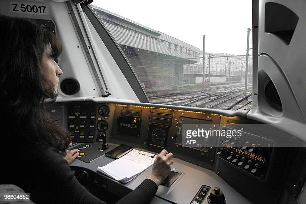A driver conducts a new Nouvelles Automotrices Transilien Bombardier train of the SNCF Transilien the public transport railroad network in Paris and...