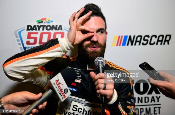 NASCAR driver Corey LaJoie speaks with the media during the Monster Energy NASCAR Cup Series 61st Annual Daytona 500 Media Day at Daytona...