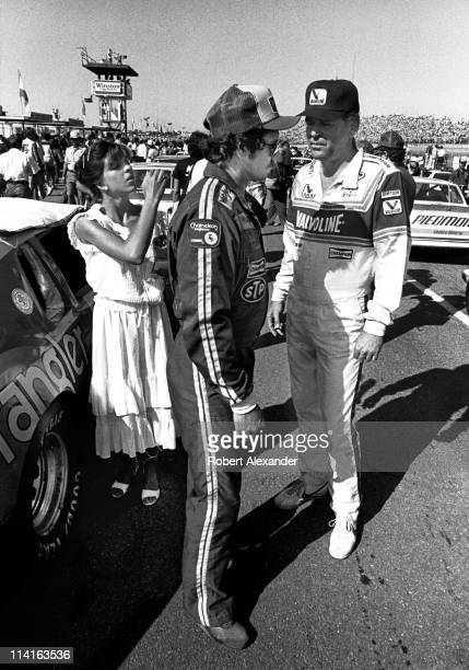 NASCAR driver Dale Earnhardt and Buddy Baker exchange some heated words prior to the start of the 1983 Firecracker 400 on July 4 1983 at the Daytona...