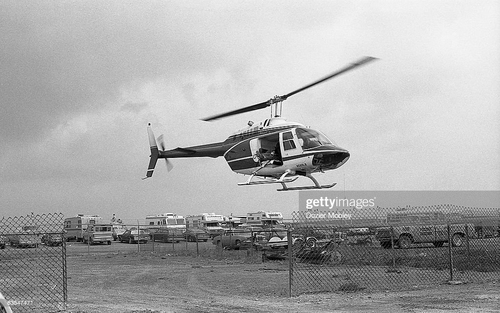 Driver Dale Earnhardt is airlifted by helicopter to the hospital after a crash on lap 98 during the Coca-Cola 500 race on July 30, 1979 at the Pocono International Raceway in Long Pond, Pennsylvania.