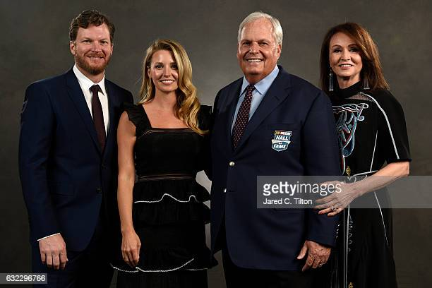 NASCAR driver Dale Earnhardt Jr and his wife Amy pose with NASCAR Hall of Fame inductee Rick Hendrick and his wife Linda after the NASCAR Hall of...