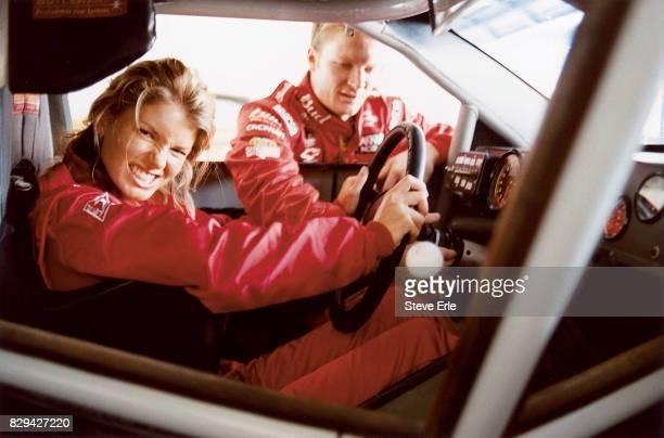 NASCAR driver Dale Earnhardt Jr and model Marisa Miller are photographed riding in his race car for Sports Illustrated in July 2002 in Daytona Beach...