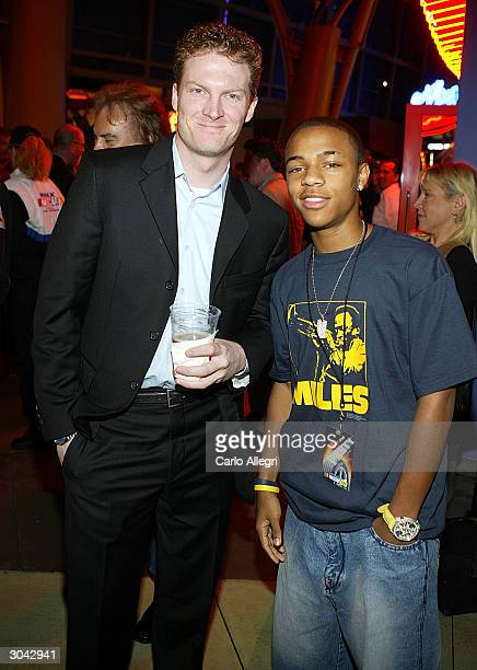 NASCAR driver Dale Earnhardt Jr and rapper Bow Wow arrive for the after party of Warner Brothers 'NASCAR 3D The Imax Experiance' at Universal Studios...